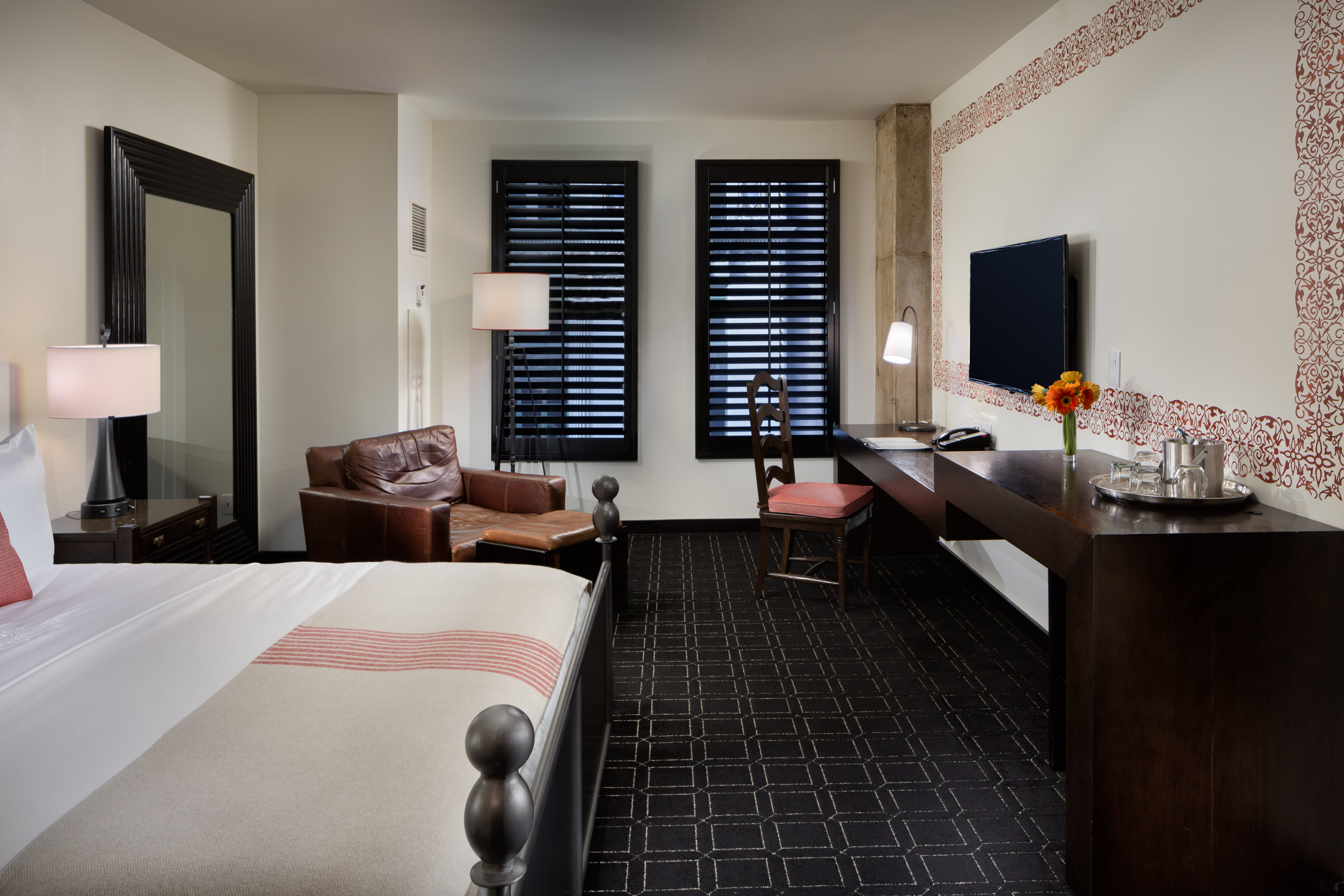 flat panel lcd color tv an oversized leather armchair desk and private bar the full bathroom offers a traditional bathtub and shower combination