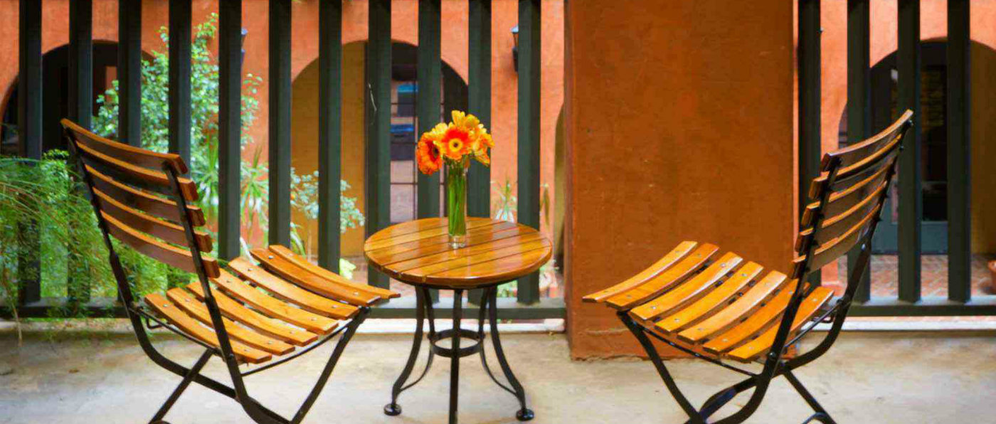 Balcony with bistro table and chairs overlooking the courtyard at Hotel Valencia Riverwalk