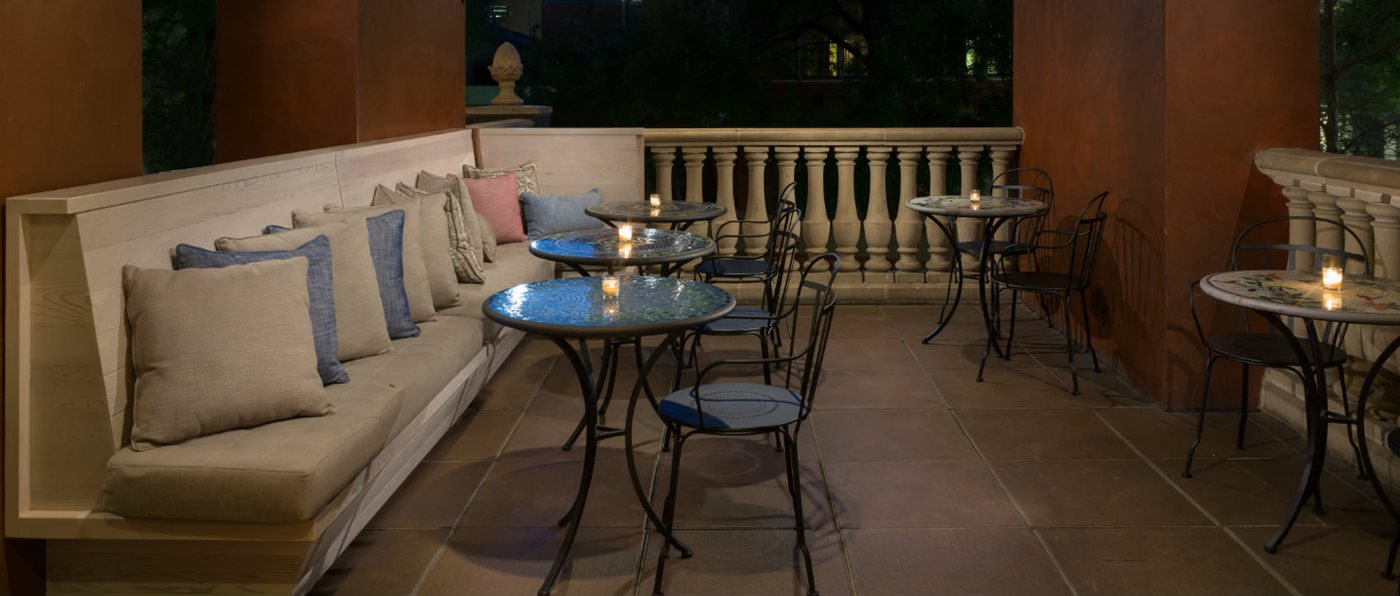Outdoor seating on the patio at Hotel Valencia Riverwalk