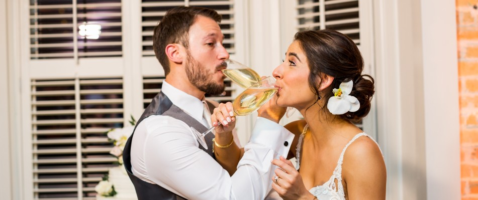 Bride and groom posing during toast